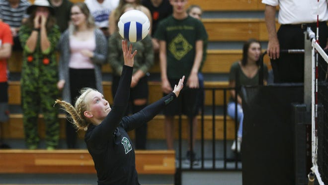 West Salem's Paige Whipple reaches up to send the ball over the net in a game against South Salem on Tuesday, Sept. 6, 2016, at West Salem High School. The West Salem Titans won the match 3-1.