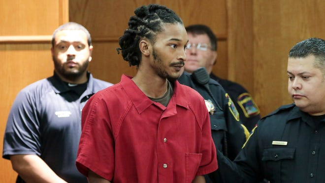 Johnthony Walker is escorted into a courtroom at the Hamilton County Justice Center, Tuesday, Nov. 29, 2016,  in Chattanooga, Tenn. Walker, the driver of a Chattanooga school bus crash that killed six children last week appeared in court, but his preliminary hearing on vehicular homicide charges was postponed.