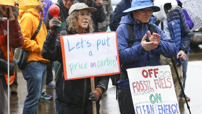 Eugene residents Sophie and Jim Swirczynski cheer at a rally for a Healthy Climate and Clean Energy Jobs on the steps of the Capitol on Wednesday, Feb. 3, 2016.