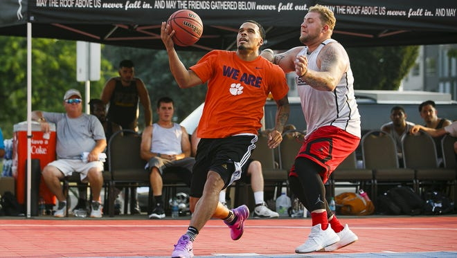 Avry Holmes, left, goes up for a basket in a Hoopla 2-on-2 tournament on Wednesday, Aug. 2, 2017, outside the Salem Convention Center. The 2-on-2 tournament kicked off Hoopla 2017. Holmes formerly played at North Salem High School.