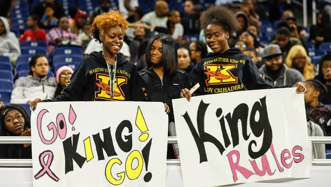 Detroit King students pose for a photo with their signs during the Detroit Public School League championship game at Ford Field, Friday, Oct. 20, 2017.