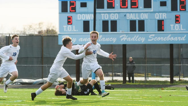 Lake Region's Brady Perron (10) celebrates scoring the game winning goal in overtime during the DII boys soccer championship game between Harwood and Lake Region at South Burlington High School on Saturday afternoon November 4, 2017 in South Burlington.