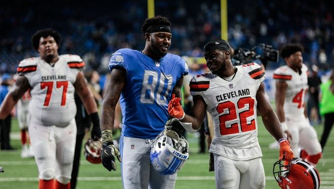 Browns safety Jabrill Peppers talks to Lions tight end Michael Roberts after the Lions' 38-24 win at Ford Field, Nov. 12.
