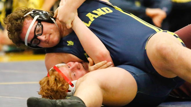 Hartland's Jon Hartman (top) had two first-period pins as the Eagles beat Birmingham Seaholm and Walled Lake Central for their 17th straight regional wrestling tile.
