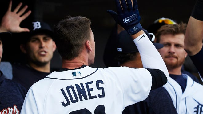 May 15, 2018; Detroit, MI, USA; Detroit Tigers center fielder JaCoby Jones (21) is congratulated by teammates after hitting a homerun in the first inning against the Cleveland Indians at Comerica Park on May 15, 2018.