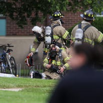 Trash scatters across the lawn outside an apartment complex on Hawkeye Drive following a reported explosion on Friday, May 27, 2016.