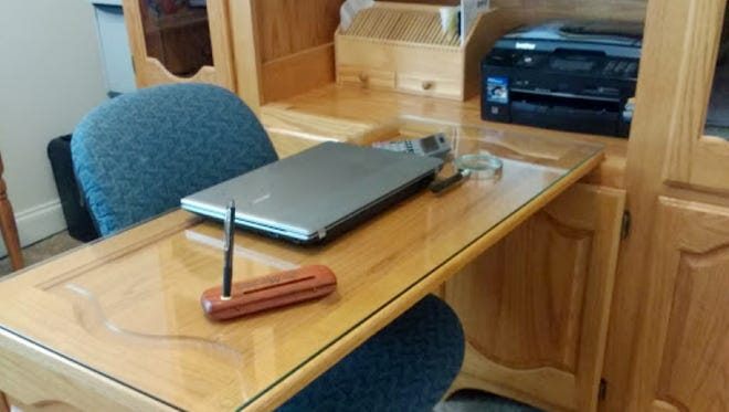 Coleen Schamante created a desk and home office storage center from an old entertainment center, cleverly using the doors for the desk top and support.