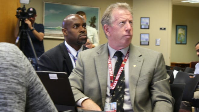 Superintendent Desmond Blackburn, left, and board member Andy Ziegler during a school workshop to discuss how to go about replacing Blackburn who announced he will be resigning to become CEO of the national nonprofit New Teacher Center.