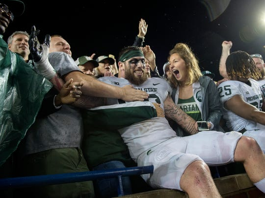 Michigan State's Chris Frey celebrates with fans after beating Michigan 14-10 on Saturday, Oct. 7, 2017, at Michigan Stadium in Ann Arbor.