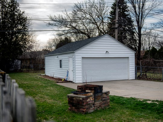 The two-car garage and backyard of Olivia McCormick's
