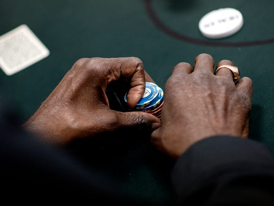 A patron holds on to his chips June 20 during a game at The Event Spot charity poker room in Delta Township. The venue is the only one of its kind in the Lansing region.