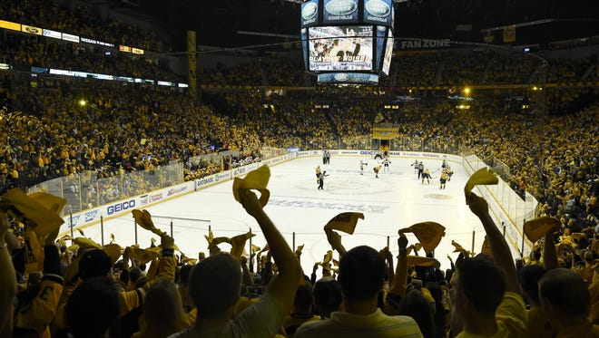 Predators fans cheer their team in the first period of game four in the first-round NHL playoff series at the Bridgestone Arena, Thursday, April 20, 2017, in Nashville, Tenn.