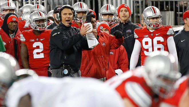 Ohio State Buckeyes head coach Urban Meyer signals from the sidelines against the Michigan State Spartans in the third quarter at Ohio Stadium. The Spartans won 17-14.