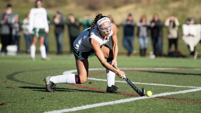 Sutton High School senior Chloe Belsito, a former gymnast, plays field hockey.