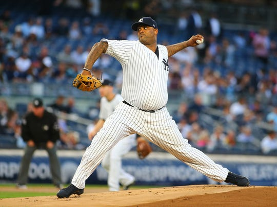 Aug 31, 2017; Bronx, NY, USA; New York Yankees starting pitcher CC Sabathia (52) pitches against the Boston Red Sox during the first inning at Yankee Stadium. Mandatory Credit: Andy Marlin-USA TODAY Sports
