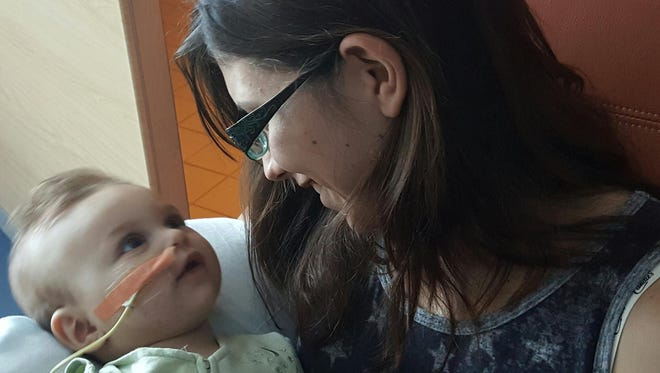 Alexa Shoultes holds her daughter, Alana Prettyman. An updated diagnosis has given the 9-month-old less time to live.