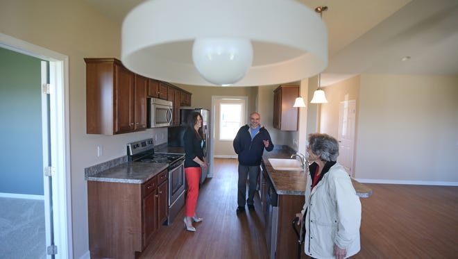 Danielle Gruttadaurio, with Nothnagle Realtors, does a final walk through on Friday, May 1, 2015 with clients Emilio Raucci, and his mother Angela Raucci, of Gates, in a home they were considering in the town of Greece.