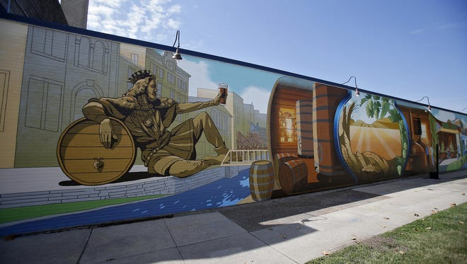 The Sam Adams Brewery unveiled a mural facing Central Parkway, depicting the community's significant history and vibrant future.