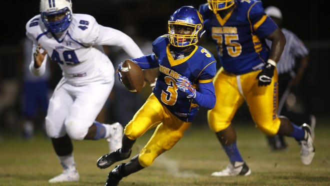 Rickards quarterback Marcus Riley scrambles out of the pocket against Godby during their game at Cox Stadium last year. Riley accounted for 556 yards of offense and seven touchdowns.