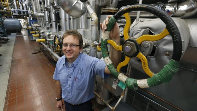 Boiler plant operator Gary Gefell at the main steam header in the Canandaigua VA Medical Center.