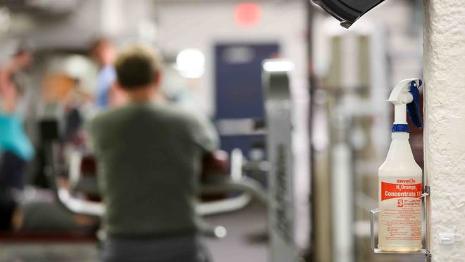 At the YMCA in Brandywine Hundred,Dot McFadden, health and wellness director, said the gym provides disinfectant solution, paper towels and Purell instant hand sanitizer throughout the facility so members can easily wipe down equipment.