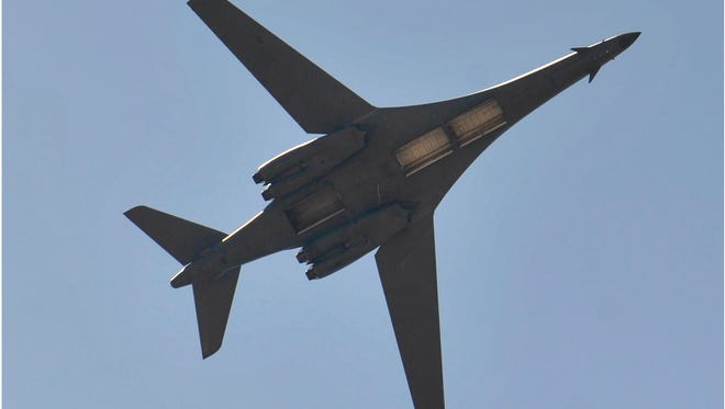 A B-1 bomber flies overhead with its bomb bay doors open during the Dyess Big Country Air & Space Expo at Dyess Air Force Base Saturday May 12, 2018.