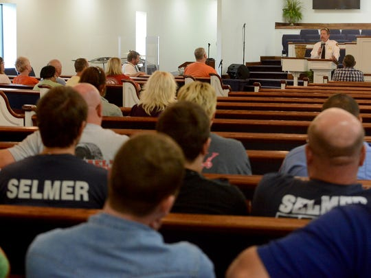 Hardin County Fire Department Chaplain Rex Humphrey offers his services during a community counseling session at Cypress Creek First Baptist Church in Selmer on Monday.