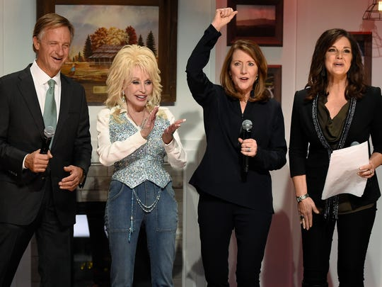 Gov. Bill Haslam, Dolly Parton, Crissy Haslam and Nan Kelley celebrate the end of the Smoky Mountains Rise telethon Dec. 13, 2016, in Nashville.