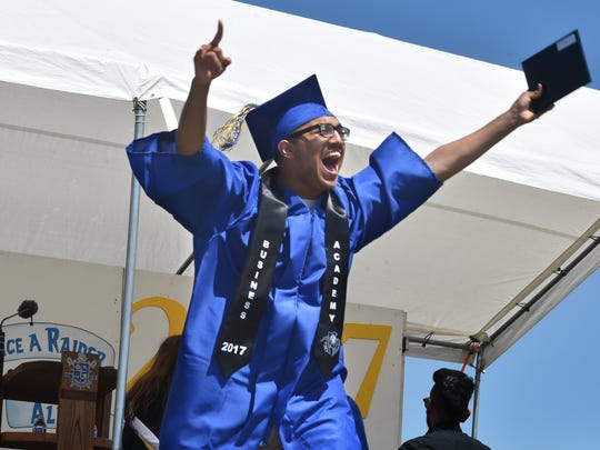 Gilbert Alexis Barroso celebrates after receiving his diploma during Channel Island High School's commencement ceremony on Friday in Oxnard. Barroso was among 500 Raiders who graduated.