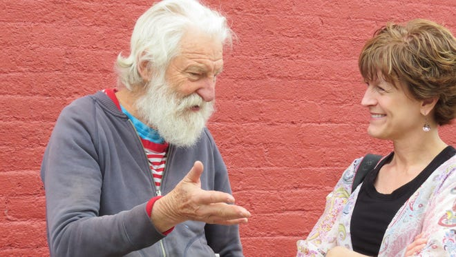 Isaiah Zagar talks to CASHS art teacher Holly Strayer during his site visit to The Foundry building, which will be the site of one of two murals he will lead the creation of in July.