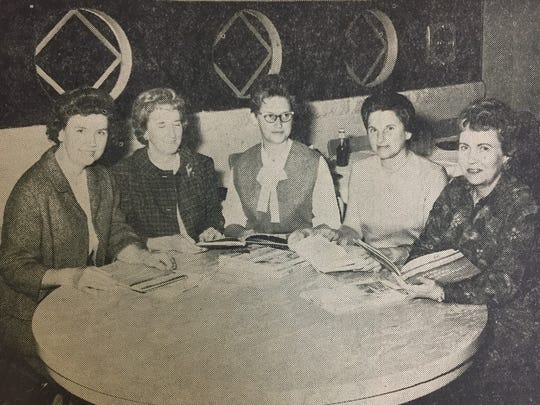 Members of the Union County Soil Conservation District Ladies Auxiliary examine some of the reference materials for the school libraries in November of 1965. They are (left to right) Lucille Rich, Katherine Sprague, Charlotte O'Nan, Irene Anderson, and Annie McElroy.