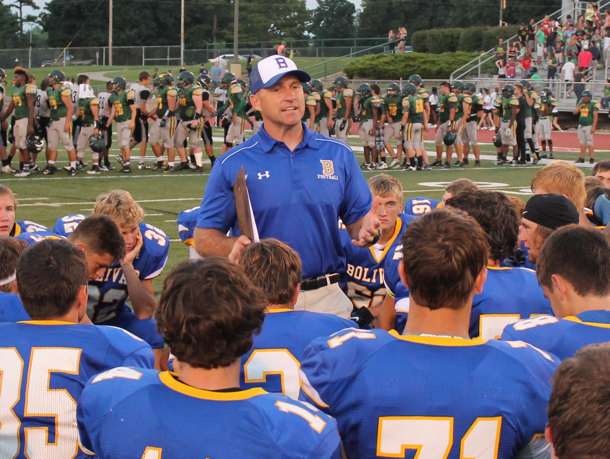 Bolivar High School football coach Lance Roweton (standing) announced he will step aside from coaching football after the Liberators won 13 consecutive COC Small championships.
