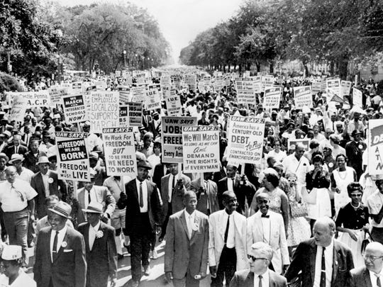Constitution Avenue in Washington D.C. appears to be filled with marchers, carrying placards, as demonstrators walk from the Washington Monument to the Lincoln Memorial for the March on Washington Aug. 28, 1963. The demonstration of 200,000 people was not marred by violence.