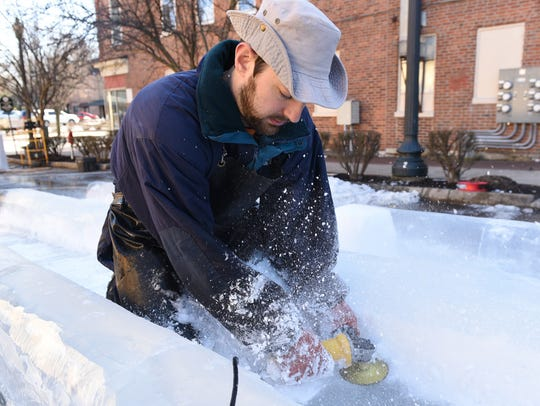 An ice carver creates an ice sculpture during IceFest in downtown Chambersburg in January 2017.