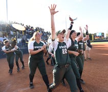 The seventh-seeded Spartans rallied for three runs...