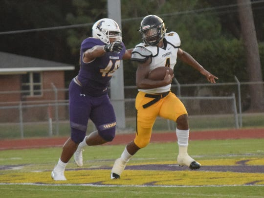 ASH senior defensive lineman Aaron Ealy (46) chases down Ferriday quarterback Kobe Dillon Friday, Aug. 31, 2018 at ASH.