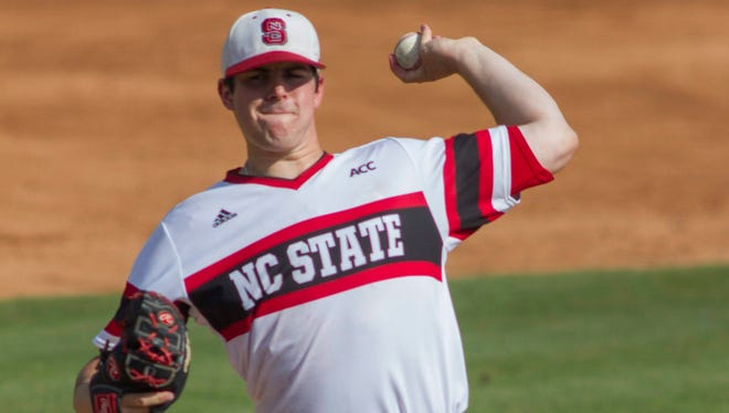 North Carolina State Wolfpack pitcher Carlos Rodon delivers against the Rice Owls during the Raleigh super regional of the 2013 NCAA baseball tournament.