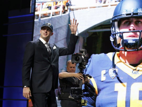 California's Jared Goff waves as after being selected by the Los Angeles Rams as 1st pick in the first round of the 2016 NFL football draft, Thursday, April 28, 2016, in Chicago. (AP Photo/Charles Rex Arbogast)