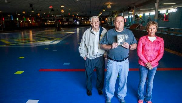 The Sheridan family stands in  the rink at Gibson Skating Arena in Muncie Tuesday, Oct. 20, 2015.