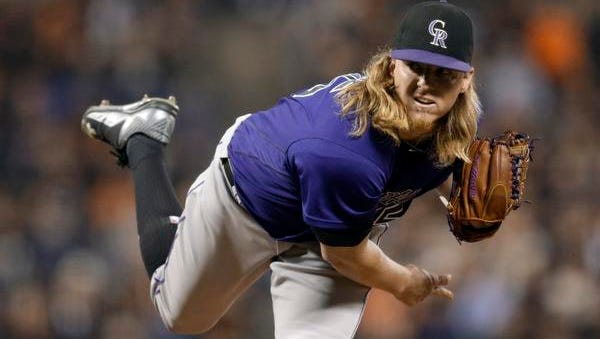 FILE - In this Sept. 29, 2016, fie photo, Colorado Rockies pitcher Jon Gray works against the San Francisco Giants during a baseball game in San Francisco. Junior Guerra pitched in Mexico and Italy before finding success with the Milwaukee Brewers. Gray arrived in Colorado just a couple years after being taken with the third overall pick in the 2013 amateur draft by the Rockies. Two right-handers who took disparate roads to the majors will share a unique distinction on Monday, April 3: opening day starters when the Rockies visit the Brewers at Miller Park. (AP Photo/Ben Margot, File)