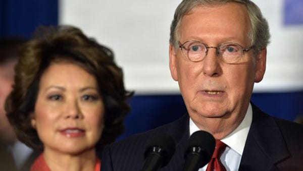 Senate Minority Leader Mitch McConnell, R-Ky., addresses supporters with wife Elaine Chao after winning renomination to the Senate.