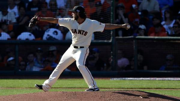 San Francisco Giants pitcher Madison Bumgarner throws during Game 3 of baseball's NL Division Series in San Francisco, Monday, Oct. 6, 2014.