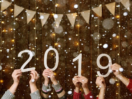 people hands showing 2019 numbers on wooden background - new year holiday concept