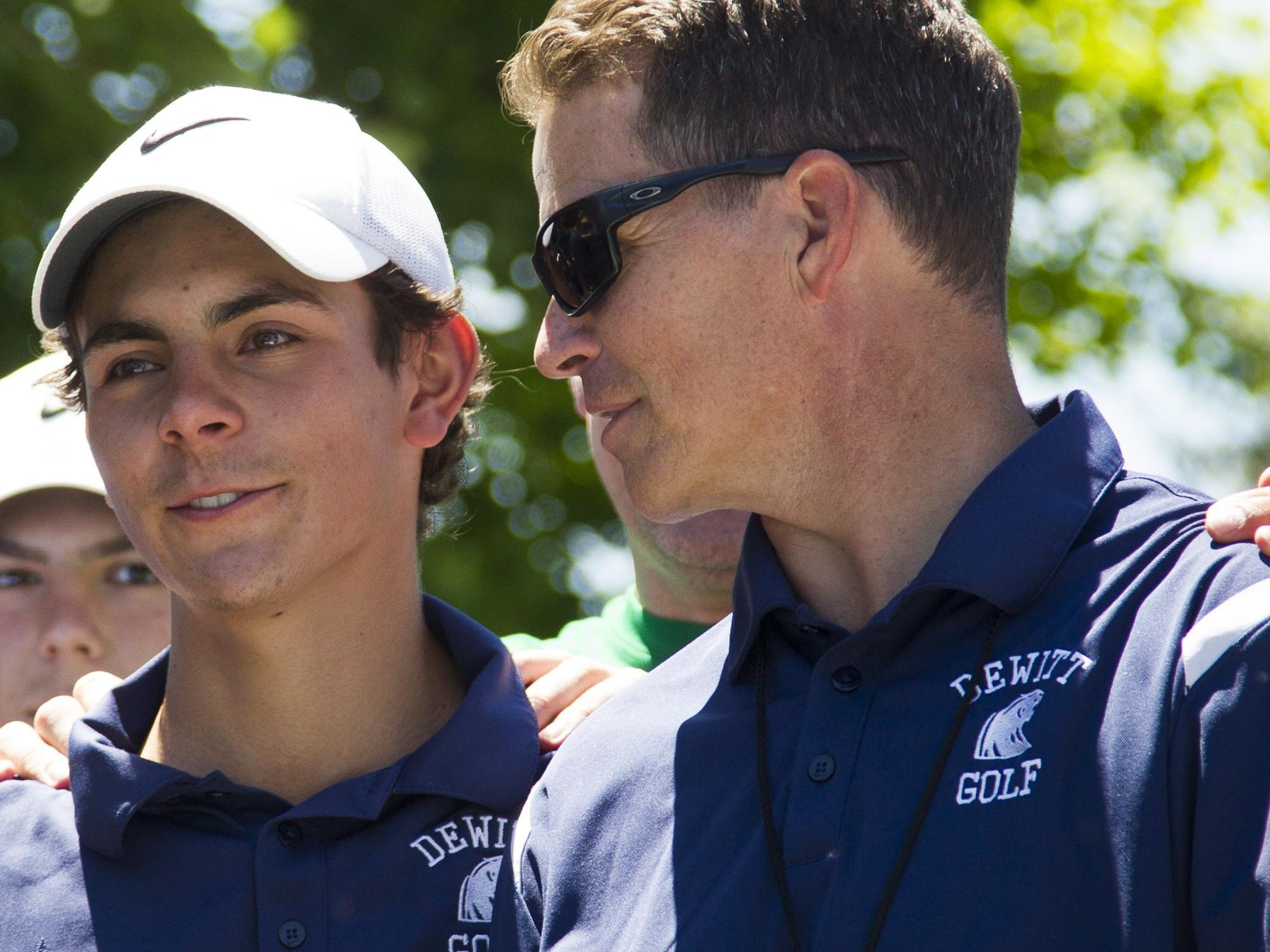 Dave Koenigsknecht, right, guided the DeWitt boys golf team to a Division 2 state title.