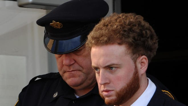 Thomas Latanowich, accused of killing Yarmouth police Sgt. Sean Gannon, is led out of Barnstable Superior Court in 2018. Preparations are underway for an in-person hearing in Barnstable Superior Court on July 21.