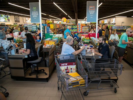ALDI customers check out after shopping early Thursday