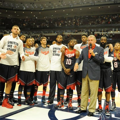 United States Basketball Managing Director Jerry Colangelo and the USA Team address the crowd after the game against  Brazil at the United Center.
