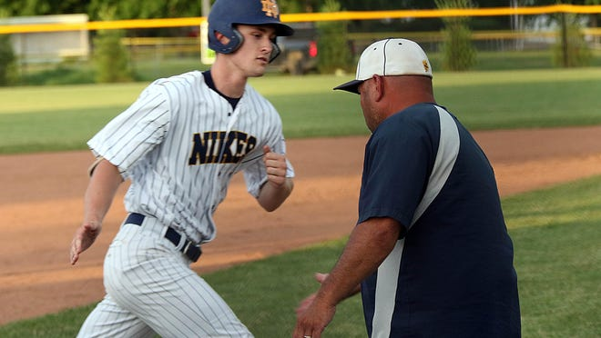 Notre Dame's Mitchell Brent is congratulated by head coach after his home run against New London at Winegard Field in Burlington Monday.