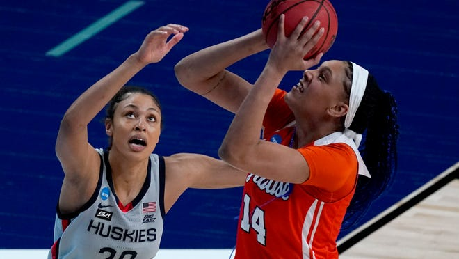 Syracuse center Kamilla Cardoso (14) shoots over UConn forward Olivia Nelson-Ododa (20) during the first half of a college basketball game in the second round of the women's NCAA tournament at the Alamodome in San Antonio, Tuesday, March 23, 2021. (AP Photo/Charlie Riedel)