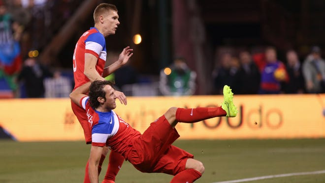 United States midfielder Mix Diskerud (10) scores a goal below forward Aron Johannsson (9) against Azerbaijan during the second half at Candlestick Park. The United States defeated Azerbaijan 2-0.